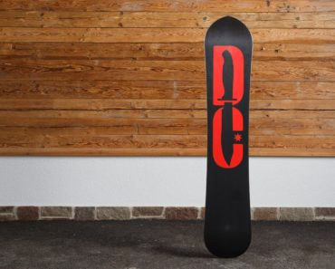 DC Supernatant snowboard leaned against a wall.