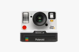 polaroid camera on white background